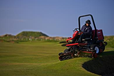 Red Ride On Mower On Golf Course