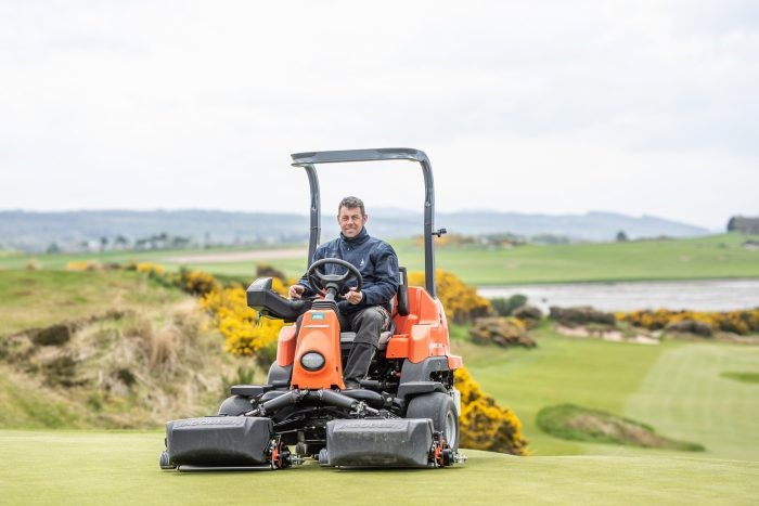 man operating ride on mower