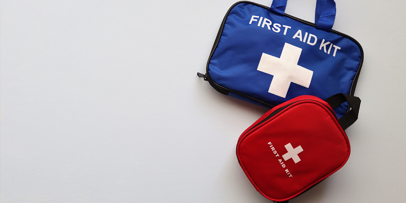 A red and blue first aid kit