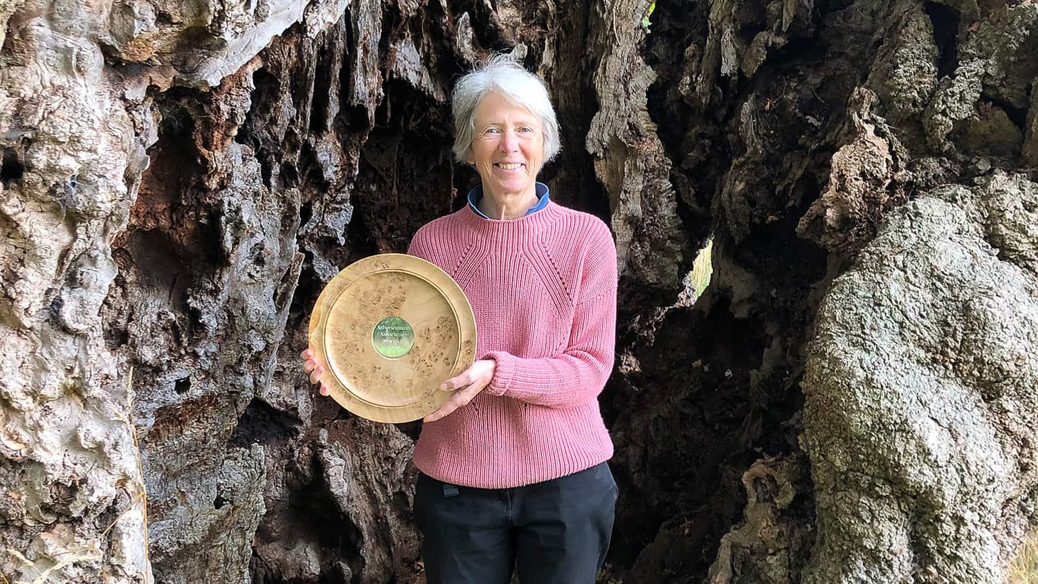 Jill holding her Arboricultural Association Trophy