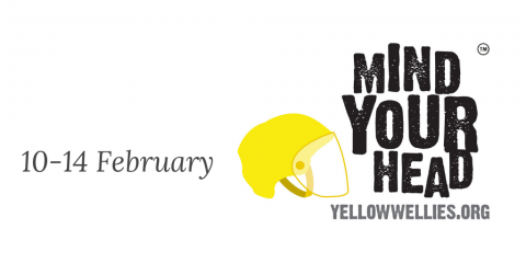 Yellow helmet with Mind Your Head slogan