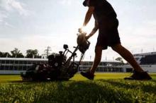 man operating lawnmower